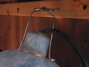 Close up of mounting hardware for chicken coop light.