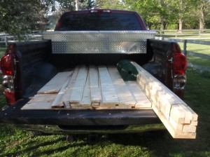 Lumber for catawba coop in the bed of a pickup truck.