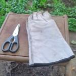 Kitchen shears next to welding gloves
