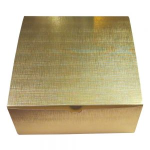 a closed gold linen gift box