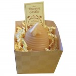 A handmade skep beeswax candle.