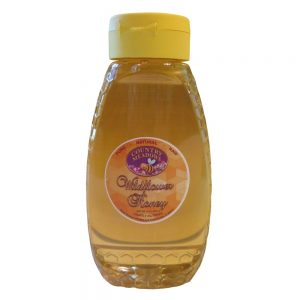 A one pound (1 lb) jar of country meadows raw wildflower honey.