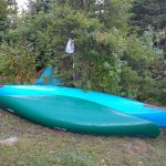 Two overturned canoes at a bwca camp site.