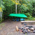 Tarp with camp chairs