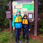 sons in front of sign for entry point 39 baker lake of the bwca