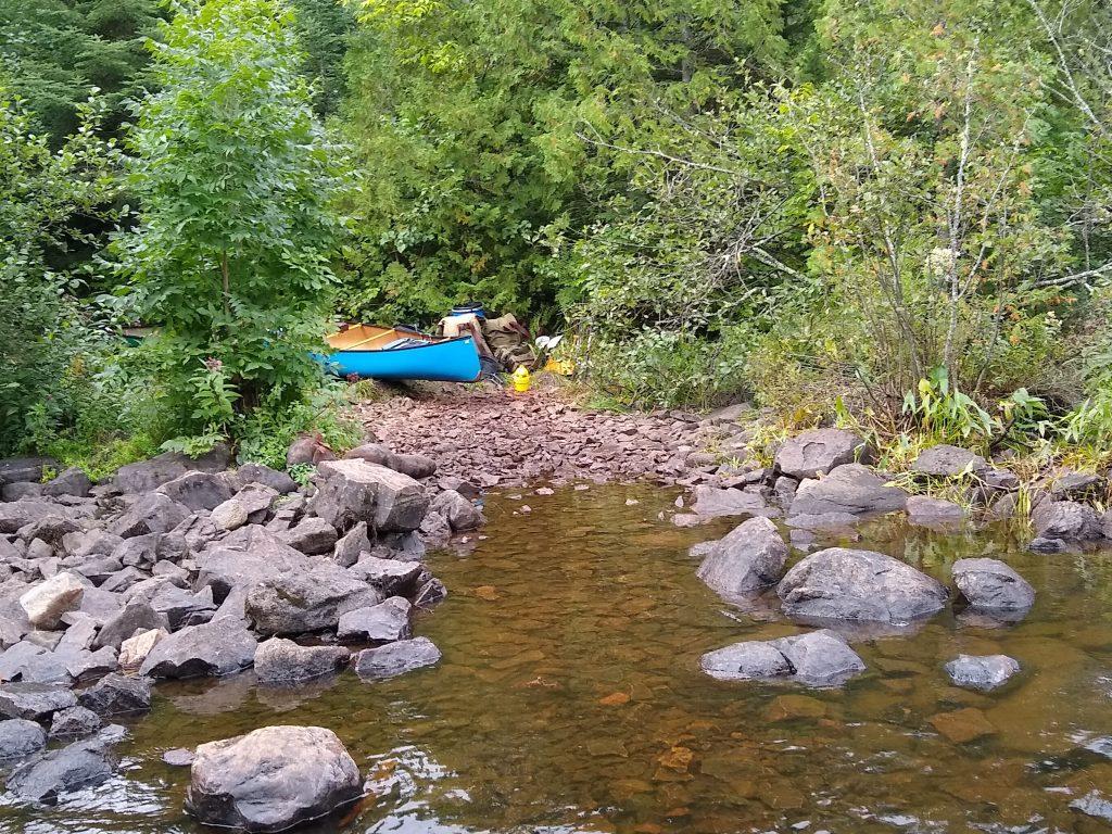 canoe resting at portage