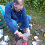 Cooking beans and rice at camp site