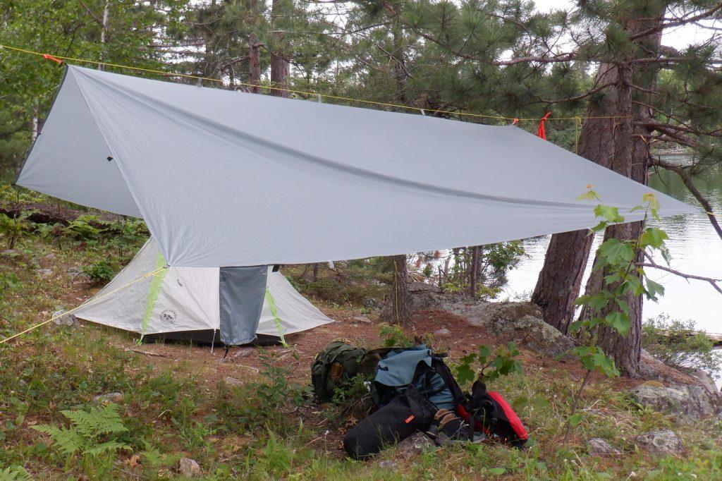 gear under a tarp