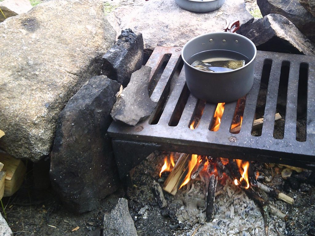 fish stock simmering on the camp fire