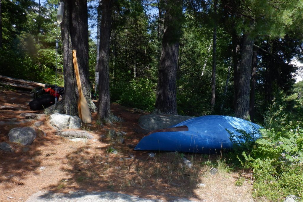stowing canoe in camp