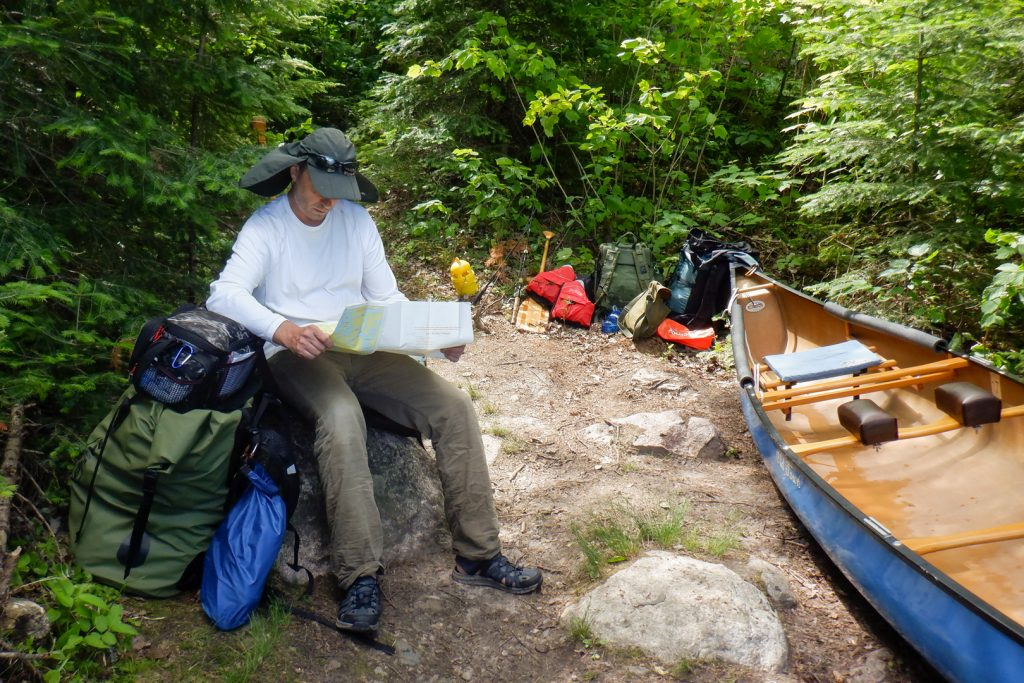 Checking the map at the portage landing.