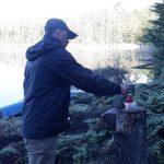 making coffee on a tree stump