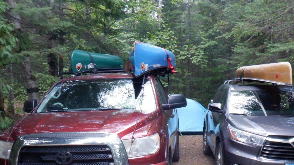 tent behind vehicles