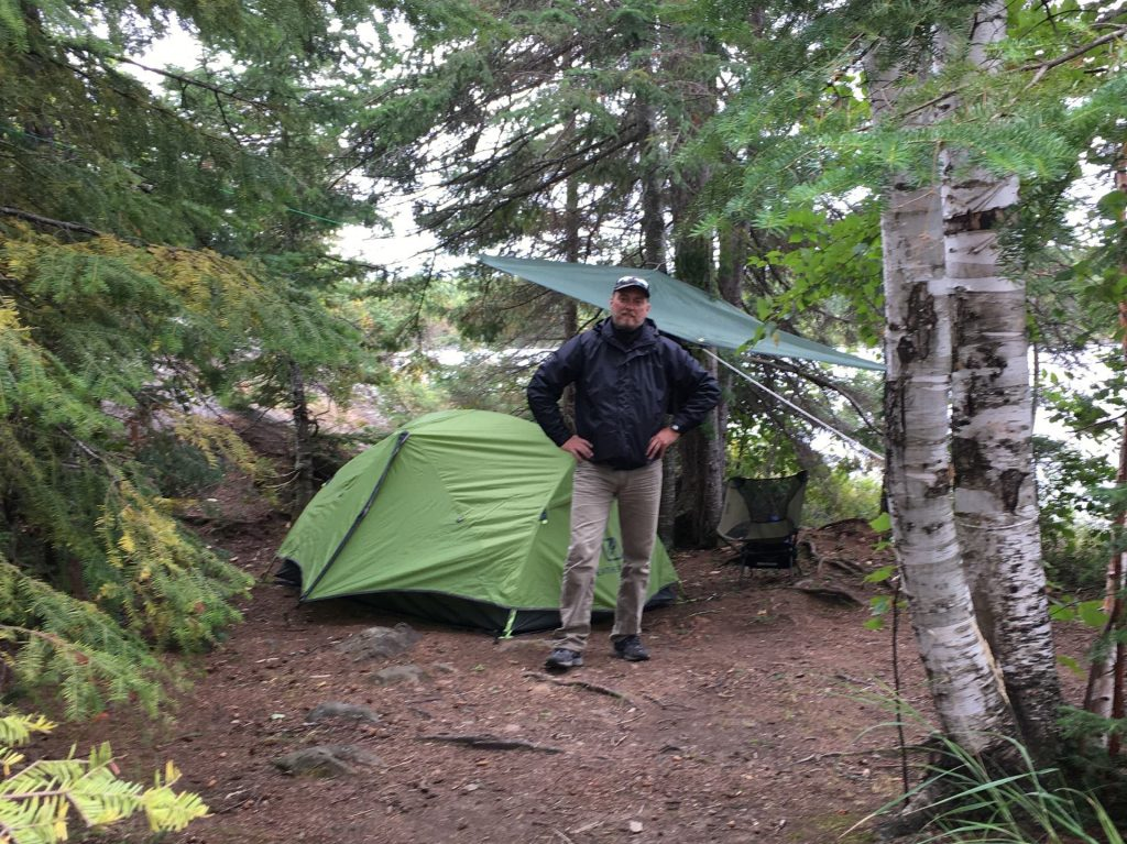standing next to a tent