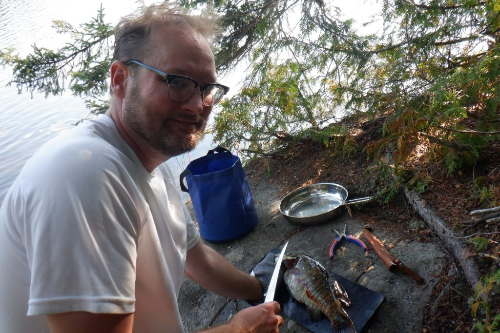 filleting a small mouth bass