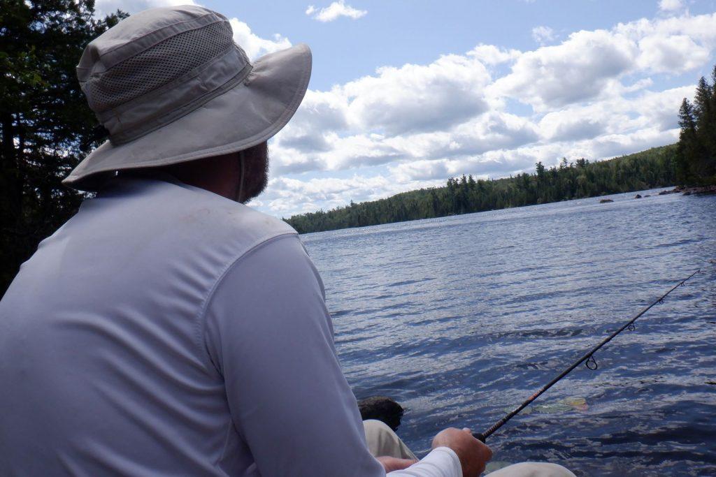 sitting on a rock fishing