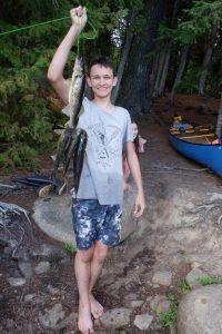 mlg holding stringer of four walleye