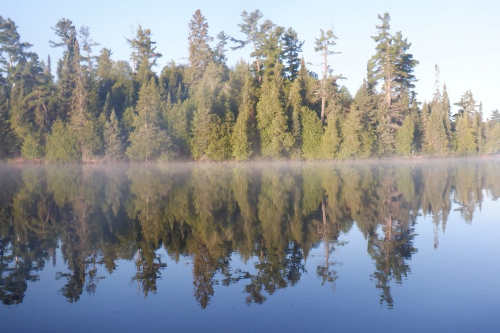 mist over calm lake